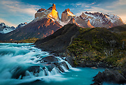 Torres del Paine National Park is a national park encompassing mountains, glaciers, lakes, and rivers in southern Chilean Patagonia. The Cordillera del Paine is the centerpiece of the park. It lies in a transition area between the Magellanic subpolar forests and the Patagonian Steppes. The park is located 112 km (70 mi) north of Puerto Natales and 312 km (194 mi) north of Punta Arenas. The park borders Bernardo O'Higgins National Park to the west and the Los Glaciares National Park to the north in Argentine territory.<br /> Torres del Paine National Park is part of the Sistema Nacional de Áreas Silvestres Protegidas del Estado de Chile (National System of Protected Forested Areas of Chile). In 2006, it measured approximately 242,242 hectares. It is one of the largest and most visited parks in Chile. The park averages around 150,000 visitors a year, of which 60% are foreign tourists, who come from all over the world.<br /> The park is one of the 11 protected areas of the Magallanes Region and Chilean Antarctica (together with four national parks, three national reserves, and three national monuments). Together, the protected forested areas comprise about 51% of the land of the region.<br /> The Torres del Paine are the peaks of the mountain range, Cerro Paine. They extend 3,050 meters above sea level, and are joined by the Cuernos del Paine. The area also boasts valleys, rivers such as the Paine, lakes, and glaciers. The well-known lakes include Grey, Pehoé, Nordenskiöld, and Sarmiento. The glaciers, including Grey, Pingo, Tyndall, and Geikie, belong to the Southern Patagonia Ice Field.