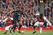 Kyle Naughton of Swansea City © takes on Alexis Sanchez (L) & Alexandre Lacazette of Arsenal (R). Premier league match, Arsenal v Swansea city at the Emirates Stadium in London on Saturday 28th October 2017.<br /> pic by Steffan Bowen, Andrew Orchard sports photography.