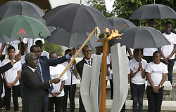 KIGALI, April 8, 2017  Rwandan President Paul Kagame (R, front) and African Union Commission Chairperson, Moussa Faki Mahamat (L, front) light the flame of remembrance at the Genocide Memorial at Gisozi in Kigali, Rwanda, on April 7, 2017. Lighting the flame of hope and laying the wreath at the Kigali Genocide Memorial Centre marked the start of the 23rd commemoration of the 1994 genocide in which more than one million people in Rwanda, mainly Tutsi and moderate Hutus, were killed.  zxj) (Credit Image: © Xinhua via ZUMA Wire)
