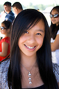 Happy smiling Hmong teen working in a concession stand. Hmong Sports Festival McMurray Field St Paul Minnesota USA