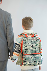 Father accompanying his son to school