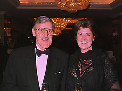 MR & MRS JIMMY HILL the TV  football presenter, at a ball in London on 17th December 1997.MEG 13