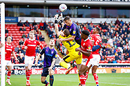 Luton Town defender Matty Pearson (6)  fouls Barnsley goalkeeper Jack Walton (13)  during the EFL Sky Bet League 1 match between Barnsley and Luton Town at Oakwell, Barnsley, England on 13 October 2018.