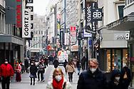 Corona Lockdown, March 18th, 2021. People on shopping street Hohe Strasse, Cologne, Germany.<br /> <br /> Corona Lockdown, 18. Maerz 2021. Menschen in der Fussgaengerzone Hohe Strasse, Koeln, Deutschland.
