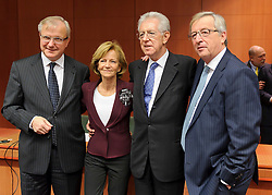 From left to right: Olli Rehn, The EU's economic and monetary affairs commissioner, Elena Salgado, Spain's finance minister, Mario Monti, Italy's prime minister, and Jean-Claude Juncker, Luxembourg's prime minister, and president of the Eurogroup, pose for photographers during a Eurogroup finance ministers meeting at the European Council headquarters in Brussels, Belgium, on Tuesday, Nov. 29, 2011. Photographer: Jock Fistick/Bloomberg *** Local Caption *** ..