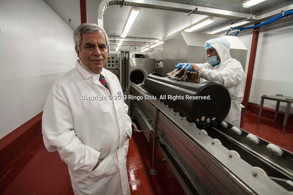 Robert Atallah, CEO of CedarLane, a frozen food manufacturer in Carson, with the the HPP machine that enables the company to keep the food fresh without using chemical preservatives. (Photo by Ringo Chiu/PHOTOFORMULA.com)