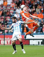 Blackpool's John Lundstram wins this aerial battle with Huddersfield Town's Jacob Butterfield<br /> <br /> Photographer Rich Linley/CameraSport<br /> <br /> Football - The Football League Sky Bet Championship - Huddersfield Town v Blackpool  - Saturday 18th October 2014 - The John Smith's Stadium - Huddersfield<br /> <br /> © CameraSport - 43 Linden Ave. Countesthorpe. Leicester. England. LE8 5PG - Tel: +44 (0) 116 277 4147 - admin@camerasport.com - www.camerasport.com