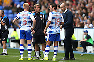 Jaap Stam, the Reading manager talking to Paul McShane of Reading and Yann Kermorgant of Reading during a drinks break. EFL Skybet  championship match, Reading  v Huddersfield Town at The Madejski Stadium in Reading, Berkshire on Saturday 24th September 2016.<br /> pic by John Patrick Fletcher, Andrew Orchard sports photography.