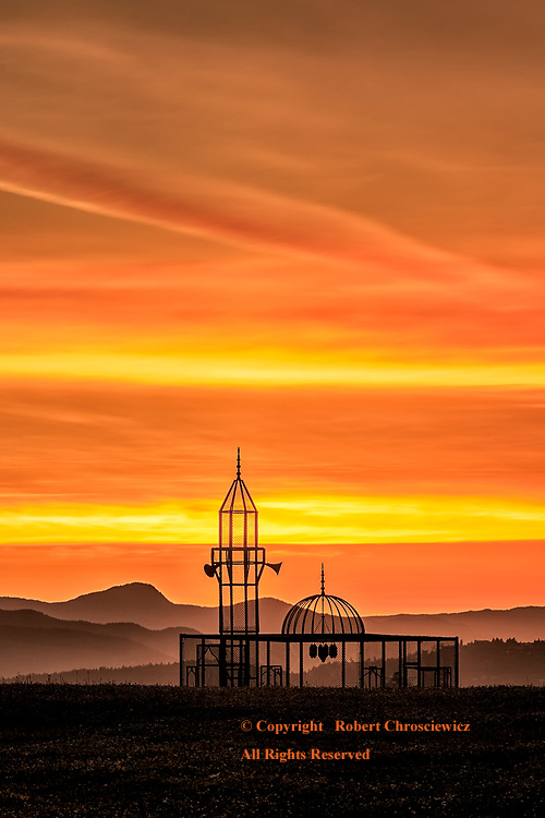 Fairytale Ending: Ajlan Gharem's artistic Mosque is made of chain link fence and evokes the feelings of imprisonment and anxiousness as it stands in contrast before a glorious sunset, Vancouver British Columbia Canada.