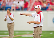 Sep 10, 2011; Little Rock, AR, USA; Arkansas Razorback head coach Bobby Petrino points as he talks with players before the start of a game against the New Mexico Lobos at War Memorial Stadium. The Razorbacks beat the Lobos 52-3. Mandatory Credit: Beth Hall-US PRESSWIRE