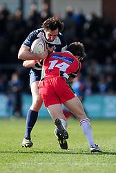 Bristol Full Back (#15) John Goodridge is tackled by Plymouth Albion Winger (#14) Lewis Warner - Photo mandatory by-line: Dougie Allward/JMP - Tel: Mobile: 07966 386802 31/03/2013 - SPORT - RUGBY - Memorial Stadium - Bristol. Bristol v Plymouth Albion - RFU Championship.