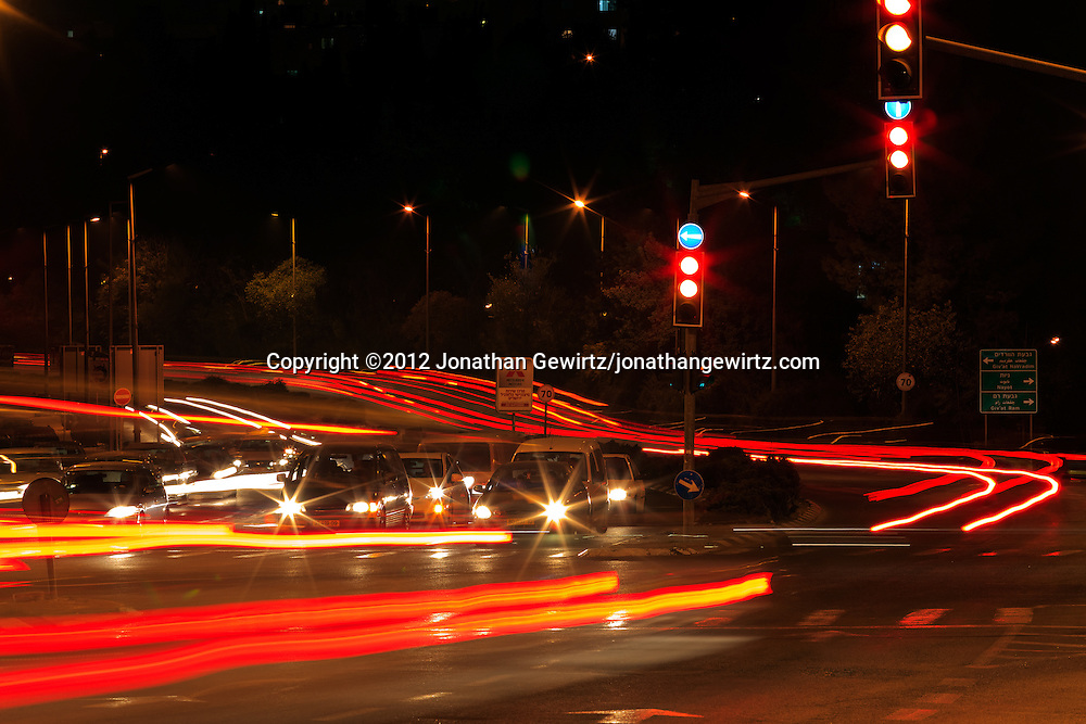 Night traffic in Jerusalem at the intersection of Herzog Street, Sderot Haim Hazaz and Tchernichovsky Street. WATERMARKS WILL NOT APPEAR ON PRINTS OR LICENSED IMAGES.