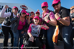 Reagan Imhoff, a Milwaukee MDA goodwill ambassador, poses with event participants during the annual MDA Ladies Run to Destination Daytona sponsored by Harley-Davidson every year on the Tuesday of Daytona Beach Bike Week. FL, USA. March 10, 2015.  Photography ©2015 Michael Lichter.
