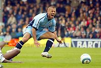 25/9/2004<br />FA Barclays Premiership - Fulham v Southampton - Craven Cottage<br />Fulham's Luis Boa Morte chops down Southampton's Kevin Phillips.<br />Photo:Jed Leicester/BPI (back page images)