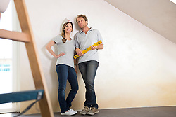 Couple decorating new home resting planning