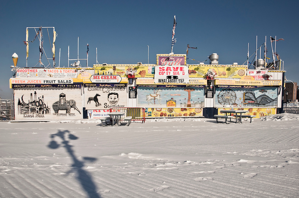 Closed stores and empty streets covered with snow during winter at Coney Island, Brooklyn, New York, 2011.