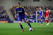 AFC Wimbledon midfielder Jack Rudoni (12) dribbling during the EFL Sky Bet League 1 match between AFC Wimbledon and Gillingham at Plough Lane, London, United Kingdom on 23 February 2021.