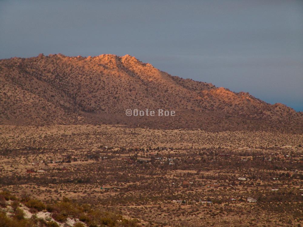 Last sun rays on top of a mountain.