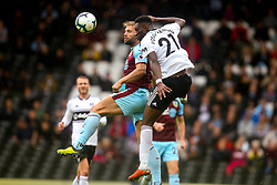 Timothy Fosu-Mensah of Fulham beats Charlie Taylor of Burnley to a header - Mandatory by-line: Robbie Stephenson/JMP - 26/08/2018 - FOOTBALL - Craven Cottage - Fulham, England - Fulham v Burnley - Premier League