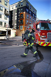 May 7, 2019 - Minneapolis, Minnesota, USA - Firefighters worked to neutralize the threat from the hazardous substance. Residents, many students were evacuated from the building. A Dinkytown apartment building was evacuated apparently after a student fell ill after being exposed to a toxic substance. (Credit Image: © Richard Tsong-Taatarii/Minneapolis Star Tribune via ZUMA Wire)