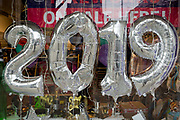 2019 balloons on display in a party shop on Kensington High Street, on 6th january 2019, in London, UK.