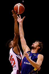 Marcus Delpeche of Bristol Flyers and Bennett Koch of Sheffield Sharks challenge at the tip off - Photo mandatory by-line: Robbie Stephenson/JMP - 13/12/2020 - BASKETBALL - Ponds Forge Sports Centre - Sheffield, England - Sheffield Sharks v Bristol Flyers - British Basketball League Championship