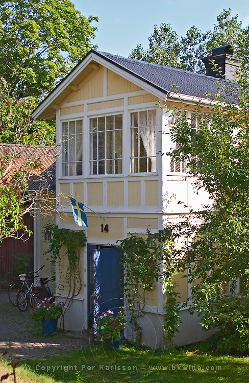 A typical wooden house in Vimmerby with glass panelled verandas. Vimmerby town Smaland region. Sweden, Europe.
