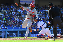 May 31, 2018 - Los Angeles, CA, U.S. - LOS ANGELES, CA - MAY 31: Philadelphia Phillies third baseman Maikel Franco (7) eludes the tag of Los Angeles Dodgers Catcher Yasmani Grandal (9) for a run during a MLB game between the Philadelphia Phillies and the Los Angeles Dodgers on May 31, 2018 at Dodger Stadium in Los Angeles, CA. (Photo by Brian Rothmuller/Icon Sportswire) (Credit Image: © Brian Rothmuller/Icon SMI via ZUMA Press)