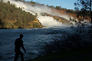 Excess water from a record winter cascades over the Oroville dam emergency spillway, used for the first time in the dam's history, and into the feather river. February 11, 2017.