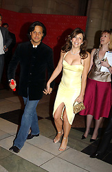 LIZ HURLEY wearing a Versace dress and Jimmy Choo shoes and ARUN NAYAR  at a party to launch 'Beauty Week' at the V&A in association with Estee Lauder- a special week of debates, talks and performances celebrating beauty on 24th January 2005.<br />