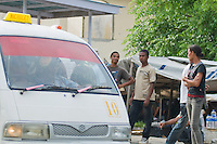 Passengers wait to board a microlet on a busy street in Dili, Timor-Leste (East Timor)