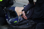 Kill the Bill demonstration in Central London against the proposed Police, Crime, Sentencing and Courts Bill on the 3rd April 2021, London, United Kingdom. A man lies arrested behind police lines. After the protest ended in Parliament Square police cleared the streets, arresting several in the process. Thousands turned out in London and across the UK to show their objection to the Governments proposed bill. Many fear the bill is meant to suppress acts of protesting and demonstrations. The police will be given greater powers to prevent and stop actions of civil disobedience and peaceful protests and many see this as a suppression of their civil liberties. Sentencing for acts of peaceful protest is also likely to be much harsher and that may also act as a deterrent to protest.