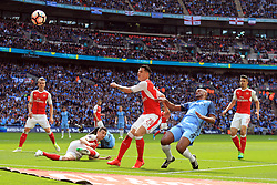 23 April 2017 - The FA Cup - Semi Final - Arsenal v Manchester City - Vincent Kompany of Manchester City  in action with Laurent Koscielny and Granit Xhaka of Arsenal - Photo: Marc Atkins / Offside.