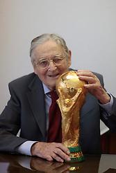 22.02.2014, Bertoni GDE, Mailand, ITA, FIFA WM, FIFA WM POKAL, Gazzaniga, im Bild Silvio Gazzaniga, 94 Jahre alt, ist ein italienischer Bildhauer. Im Jahre 1971 entwarf er den FIFA WM-Pokal die Trophae, die seit 1974 an den Fussballweltmeister ueberreicht wird. Die Trophae wurde in der Originalfabrik in Bertoni GDE, naehe Mailand hergestellt. Auf dem Bild ist ein Replikat zu sehen // during a Photoshooting of Silvio Gazzaniga, who is designed the FIFA Worldcup Trophy in the Year 1971 at the Bertoni GDE in Mailand, Italy on 2014/02/22. EXPA Pictures © 2014, PhotoCredit: EXPA/ Eibner-Pressefoto/ Cezaro<br /> <br /> *****ATTENTION - OUT of GER*****