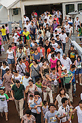Crowd of people exiting a Huangpu River ferry Shanghai, China