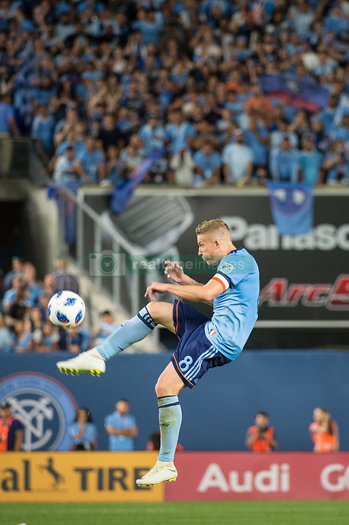July 8, 2018 - Bronx, New York, United States - New York City midfielder ALEXANDER RING (8) jumps to clear the ball during a regular season match at Yankee Stadium in Bronx, NY.  New York City FC defeats the New York Red Bulls 1 to 0 (Credit Image: © Mark Smith via ZUMA Wire)