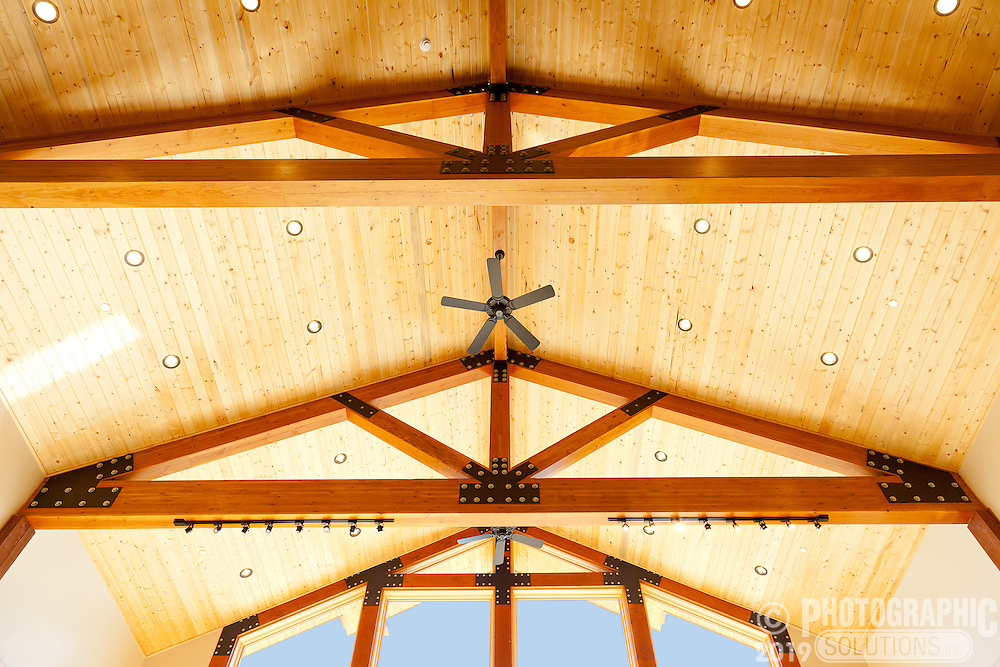 The beams were custom designed for the huge span that was needed for this custom cabin. You do not want to have to change the lightbulbs up there!