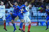 MJ Williams has his shirt pulled  during the The FA Cup 2nd round match between Rochdale and Portsmouth at Spotland, Rochdale, England on 2 December 2018.