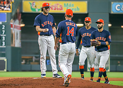 April 29, 2018 - Houston, TX, U.S. - HOUSTON, TX - APRIL 29:  After striking out 12 hitters Houston Astros starting pitcher Gerrit Cole (45) hands the ball over to Houston Astros manager AJ Hinch (14) in the top of the seventh inning during the baseball game between the Oakland Athletics and Houston Astros on April 29, 2018 at Minute Maid Park in Houston, Texas.  (Photo by Leslie Plaza Johnson/Icon Sportswire) (Credit Image: © Leslie Plaza Johnson/Icon SMI via ZUMA Press)