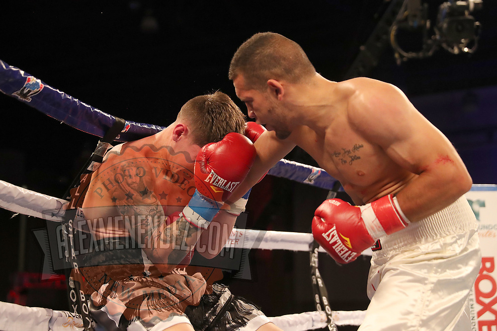 Jovan Perez gets punched by Julian Adrian Martinez during a Telemundo boxing match at Osceola Heritage Park on Friday, July 20, 2018 in Kissimmee, Florida.  (Alex Menendez via AP)