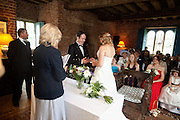 Elaine & Neil exchange rings at their wedding ceremony in Holme Pierrepont Hall