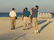 group of tourists walking on to the beach Miami USA