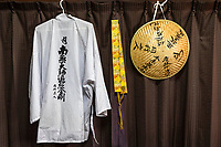 It is not necessary to wear or use all of these items, which can be obtained at many stores and temples along the pilgrimage route, at a minimum it is recommended that pilgrims wear a white vest at least so as to be recognized along the route.  White Vest Hakue 白衣 are worn over over shirts or blouses, often white.  Sedge Hats Sugegasa 菅笠 are helpful to keep the sun out of the eyes and to keep cool. Brocade Stoles Wagesa 輪袈裟 are symbolic of a full Buddhist robe and shows devotion.  Staffs are also part of the gear but are meant to be left at the temple vestibule to avoid dirt.
