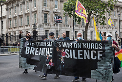 London, UK. 3rd July, 2021. Members of the Kurdish community and supporters take part in a Defend Kurdistan demonstration. Defend Kurdistan is an international initiative begun in June 2021 calling for a halt to Turkish attacks on, and the withdrawal of all Turkish troops and Islamist mercenaries from, South Kurdistan. Similar demonstrations took place in other cities around the world.