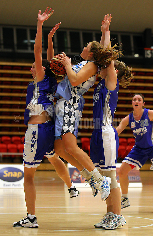 PERTH, AUSTRALIA - JULY 16: Jasmine Hooper of the Tigers lays up against Rosie Tobin and Belind O'Halloran of the Hawks during the week 18 SBL game between the Perry Lakes Hawks and the Willetton TIgers at The State Basketball Center on July 16, 2011 in Perth, Australia.  (Photo by Paul Kane/All Sports Photography)