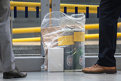 © Licensed to London News Pictures . 01/01/2019 . Manchester, UK. Detectives remove bagged evidence from Victoria Station . Anti terrorism police have closed off Victoria Station in Manchester and launched an investigation after several people were stabbed , including a British Transport Police officer , in a knife attack last night (Monday 31st December 2018). A man is under arrest for attempted murder . Photo credit: Joel Goodman/LNP