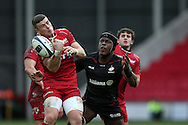 Scott Williams of the Scarlets (l) miss times his catch while under pressure from Maro Itoje of Saracens (r).  European rugby Champions cup match, pool 3, Scarlets  v Saracens at the Parc y Scarlets in Llanelli, West Wales on Sunday 15th January 2017.<br /> pic by  Andrew Orchard, Andrew Orchard sports photography.