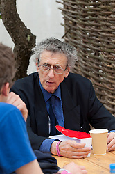 © Licensed to London News Pictures. 04/06/2016. Hay-on-Wye, Powys, Wales, UK.  Piers Corbyn talks to members of the audience over coffee. Controversial Climatologist/Meteorologist Piers Corbyn, brother of the Labour leader, Jeremy Corbyn, gives a presentaion at the Globe site,about the hoax of man made global warming on the tenth day of 'HowTheLightGetsIn' Festival of Ideas - The philosophy and music festival at Hay-on-Wye, Wales, UK. HowTheLightGetsIn festival was founded by post-realist philosopher and director of the Institute of Art and Ideas, Hilary Lawson. Photo credit: Graham M. Lawrence/LNP
