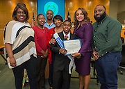Cornelius Elementary School student Chase Roberts poses for a photograph with his family and Houston ISD Board of Trustees President Rhonda Skillern-Jones after reciting his MLK Oratory Competition winning speech during the Board of Trustees meeting, February 12, 2015.