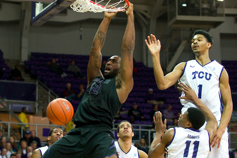 FORT WORTH, TX - JANUARY 7: Thomas Gipson #42 of the Kansas State Wildcats dunks the ball against the TCU Horned Frogs on January 7, 2014 at Daniel-Meyer Coliseum in Fort Worth, Texas.  (Photo by Cooper Neill/Getty Images) *** Local Caption *** Thomas Gipson